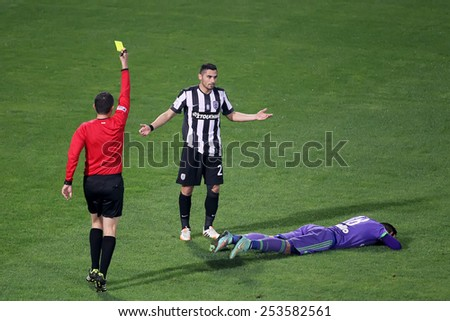 THESSALONIKI, GREECE NOVEMBER 9, 2014 : The referee shows the yellow card to a player during the Greek Superleague match PAOK vs Panathinaikos - stock photo