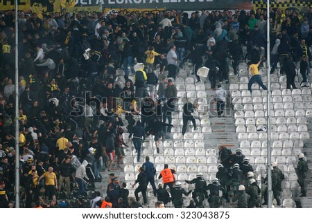 THESSALONIKI, GREECE - OCTOBER 01, 2015: Borussia Dortmund fans clash with riot police during the UEFA Europa League match between PAOK and Borussia Dortmund played at Toumba Stadium. - stock photo