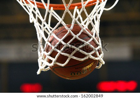 THESSALONIKI, GREECE - OCTOBER 30: PAOK BC vs TED Ankara EuroCup, Balls in the net of a Basetball hoop on October 30 in PAOK Sports Arena,Thessaloniki,Greece - stock photo