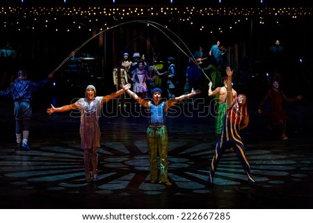 THESSALONIKI, GREECE - OCTOBER, 1, 2014: Performers skipping Rope at Cirque du Soleil's show 'Quidam'  - stock photo