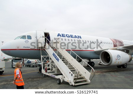 THESSALONIKI, GREECE   OCTOBER 16th, 2016: Boarding An Airplane At The  Airport Field