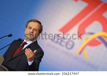 THESSALONIKI,GREECE - SEPT 17: Leader of New Democracy Antonis Samaras (L) and his wife Georgia (R) during the 76th Thessaloniki International Fair (TIF) on Sept 17, 2011 in Thessaloniki, Greece.
