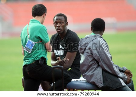 THESSALONIKI, GREECE -SEPTEMBER 11:Jamaican U. Bolt (C) relaxing in the training center for the IAAF World Athletics Finals main event in Kaftatzoglio Stadium on September 11, 2009 in Thessaloniki,Greece - stock photo