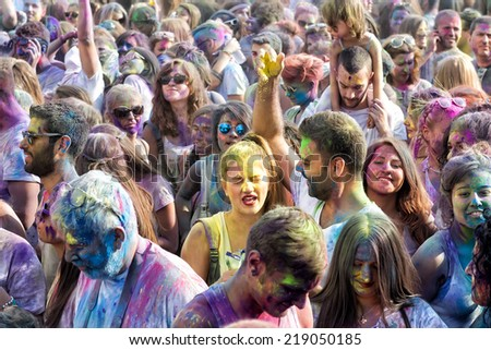 THESSALONIKI, GREECE- SEPTEMBER 14, 2014: Participants at the 3rd Colors day in Thessaloniki, Greece. A recreation of the famous Holi festival celebrated in India, took place in Thessaloniki Greece. - stock photo