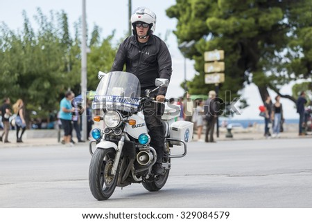 Thessaloniki, Greece, September 29 2015. Policeman on a motorcycle in a central street of Thessaloniki during the 3rd International Circuit cycling - stock photo