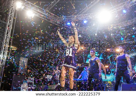 THESSALONIKI, GREECE, SEPTEMBER 11, 2014: Singer Despina Vandi  performing at MAD North Stage festival by Thessaloniki International Fair. Blur stage spotlights with laser rays in the background.  - stock photo