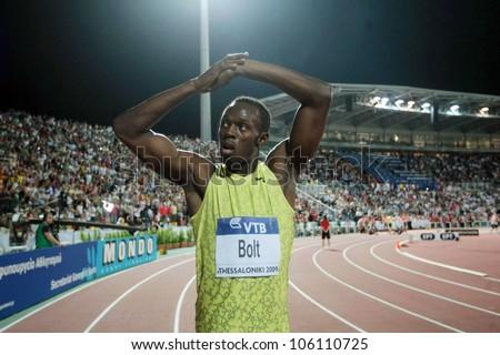 THESSALONIKI, GREECE - SEPTEMBER 12: Usain Bolt finishes first at 100m men for the IAAF World Athletics Finals main event at Kaftatzoglio Stadium on September 11, 2009 in Thessaloniki, Greece - stock photo