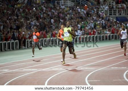 THESSALONIKI, GREECE -SEPTEMBER 12: Usain Bolt finishes first at 100m men for the IAAF World Athletics Finals main event in Kaftatzoglio Stadium on September 11, 2009 in Thessaloniki, Greece - stock photo