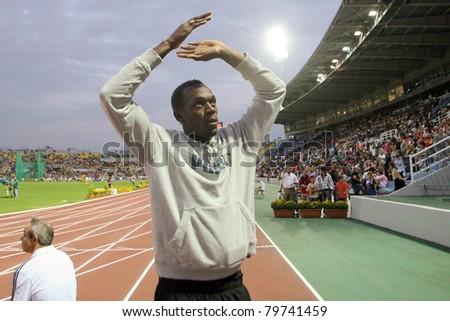 THESSALONIKI, GREECE -SEPTEMBER 12: Usain Bolt waves to the crowd at the IAAF World Athletics Finals main event in Kaftatzoglio Stadium on September 11, 2009 in Thessaloniki, Greece - stock photo