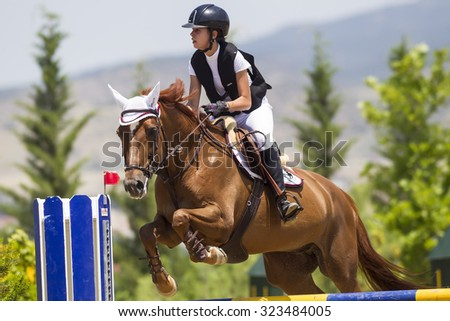 Thessloniki, Greece, June 14, 2015: Unknown rider on a horse during competition matches riding round obstacles