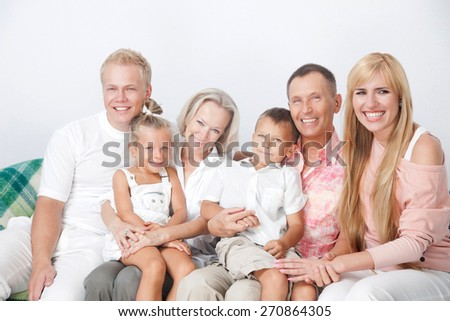 They happy because they have close-knit family. - stock photo
