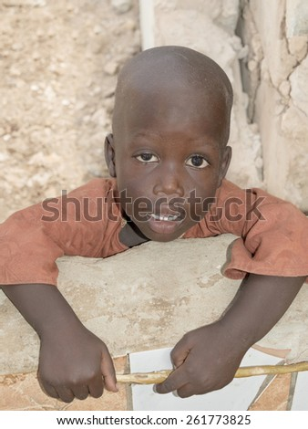 Thiaroye, Senegal, Africa, August 2, 2014, Unidentified little boy standing in the street, popular district of Guinaw Rails - stock photo