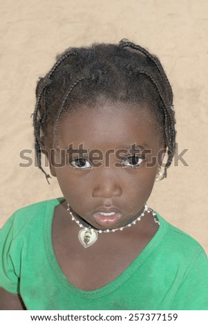Thiaroye, Senegal, Africa, July 24, 2014, Unidentified little girl standing in the street, popular district of Guinaw Rails - stock photo