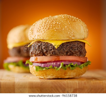 thick cheeseburgers with sesame seed bun - stock photo