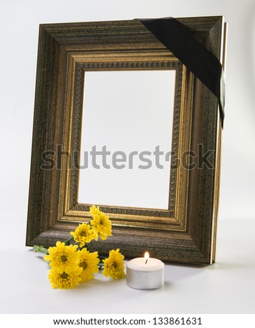 thick gold frame with candle - stock photo