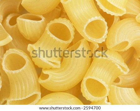 Thick' hollow and short macaroni. Close-up. Cooking ingredients