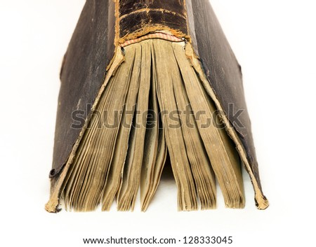 Thick old book on the white background - stock photo