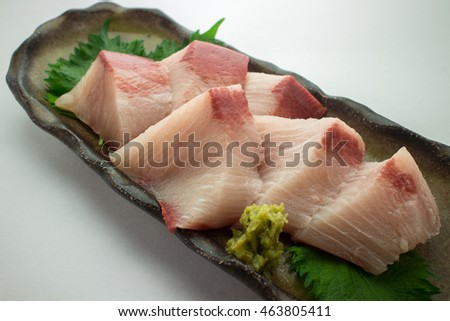 Thick piece of yellowtail sashimi
