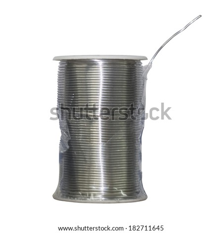 Thick roll of thin welding steel wire on white background.