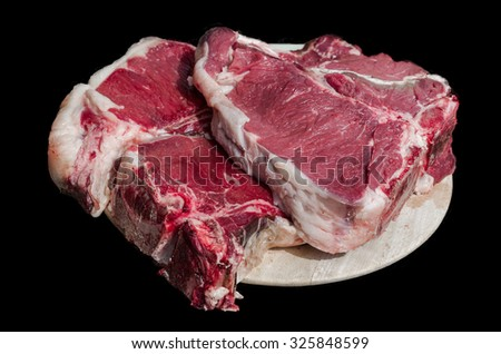 Thick slice of meat with bone from chianina cow - stock photo