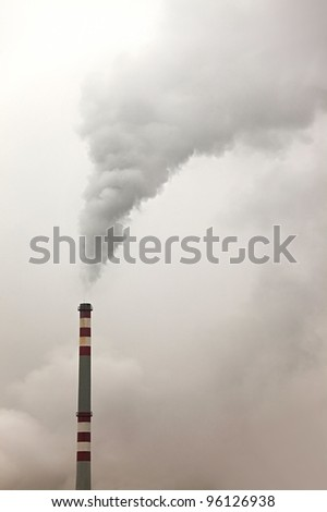 Thick smoke rising from an industrial chimney