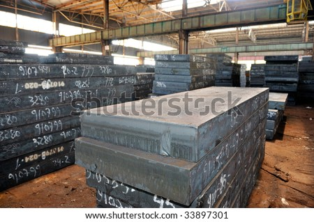 thick steel sheets in a warehouse