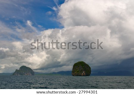 Thick Thunderstorm Clouds Moving over the Sea - stock photo