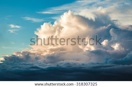 Thick white clouds in the blue sky - stock photo