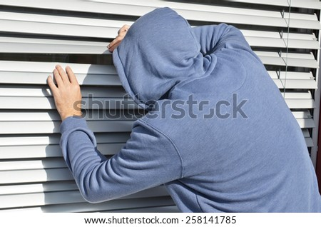 Thief at the window - stock photo