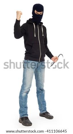 Thief burglar in balaclava mask with metal crowbar - stock photo