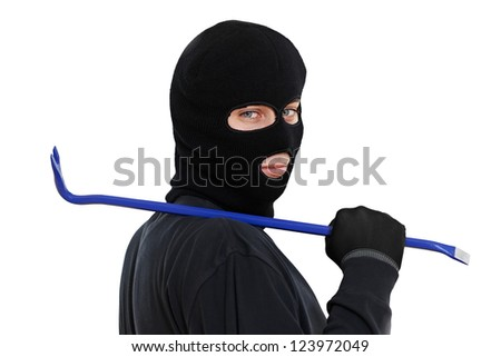 Thief Burglar in balaclava mask with metal crowbar Isolated - stock photo