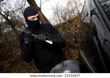 thief car try to open the car - stock photo
