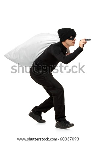 Thief carrying a bag and holding a torch isolated against white background