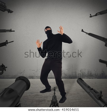 Thief caught red-handed - stock photo