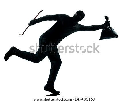 thief criminal running in silhouette studio isolated on white background in silhouette studio isolated on white background