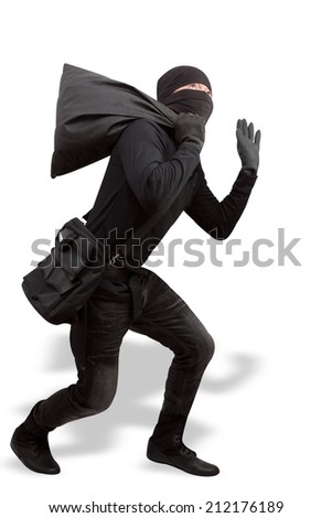 thief dressed in black and wearing a balaclava stealing valuables by bag in concept  criminal committing isolated on white background with clipping path - stock photo