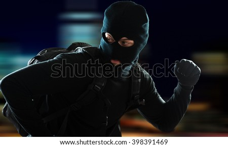 Thief escaping  - stock photo