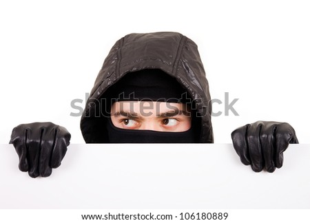 Thief hiding on white background - stock photo
