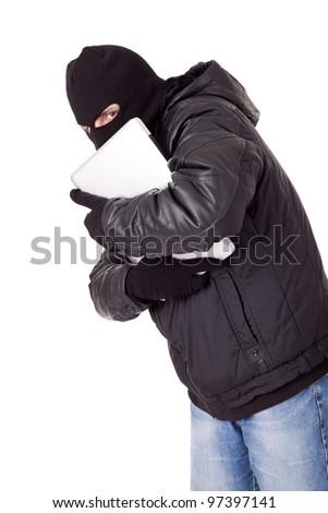 Thief holding a white laptop - stock photo