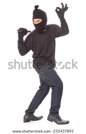Thief holding flashlight, isolated on white background  - stock photo