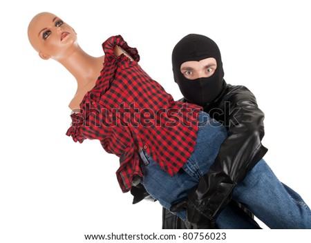 thief in black balaclava and leather jacket with manequin - stock photo