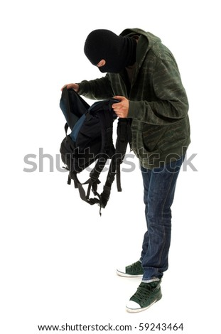 thief in black balaclava with stolen backpack - stock photo