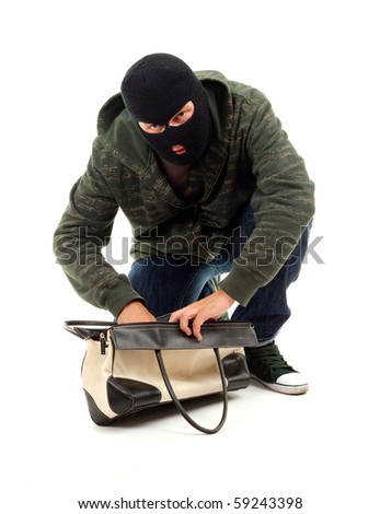 thief in black balaclava with stolen bag - stock photo