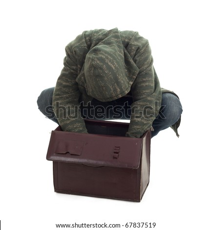 thief in black balaclava with stolen suitcase - stock photo