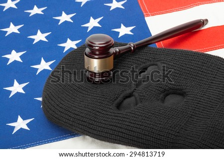Thief mask with judge gavel and USA flag