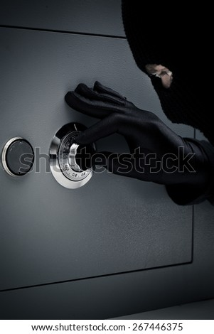 Thief opening safe - stock photo