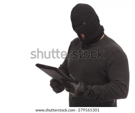 Thief or man in a mask with a digital tablet on a white background.