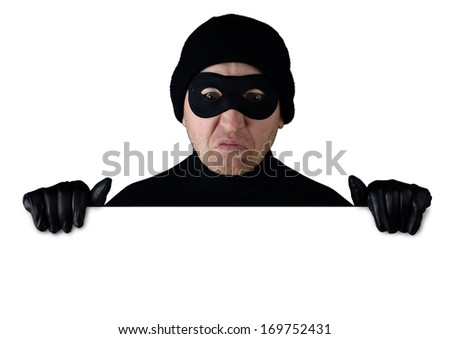 Thief peering over the top of isolated white copy space - stock photo