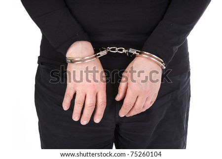 thief's hands in handcuffs isolated on white background