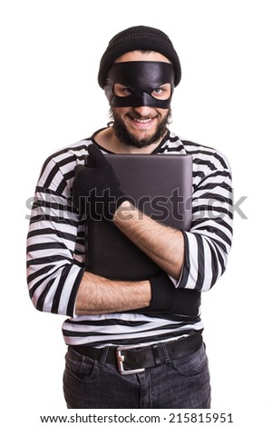Thief stealing a laptop computer. Portrait isolated on white background  - stock photo